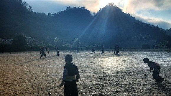 Children play a folk fame football in Huatat Village