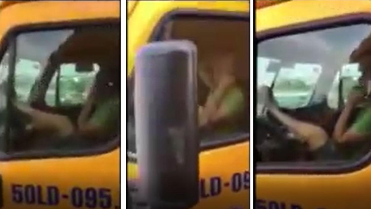 VIDEO: Tài xế xe container tay cầm điện thoại, lái xe bằng chân qua