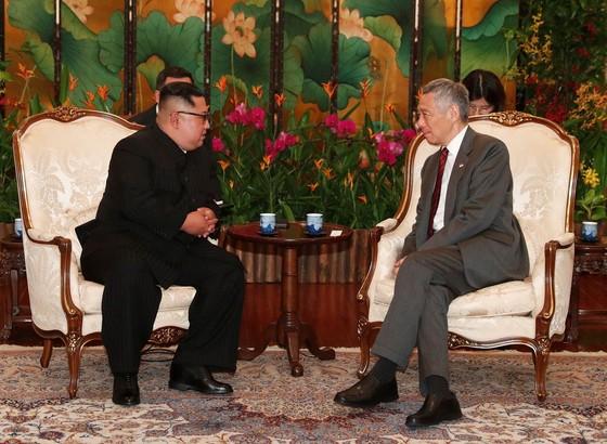 美總統抵新 金正恩會見李顯龍 ảnh 2