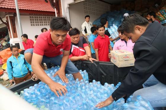 Lực lượng cứu hộ quốc tế đổ về Lào cứu trợ sau vụ vỡ đập thủy điện ảnh 6