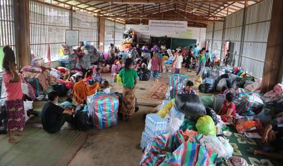 Lực lượng cứu hộ quốc tế đổ về Lào cứu trợ sau vụ vỡ đập thủy điện ảnh 10