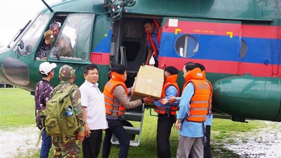 Việt Nam hỗ trợ Lào khắc phục sự cố vỡ đập thủy điện ảnh 1
