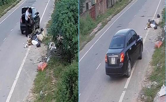 Lái ô tô chở rác vứt xuống đường, một người đàn ông bị phạt hành chính  ảnh 1