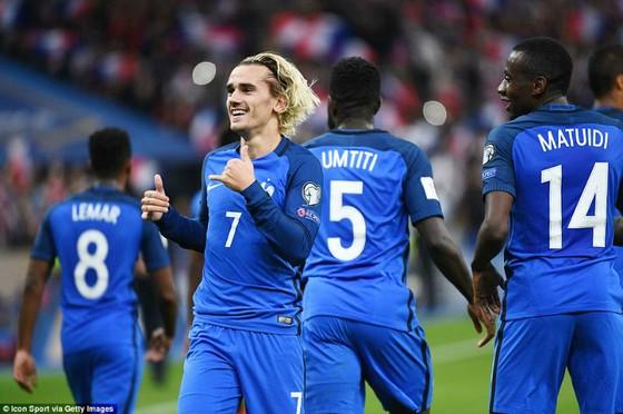 Antoine Griezmann hạnh phúc khi cùng tuyển Pháp. Ảnh: Getty Images