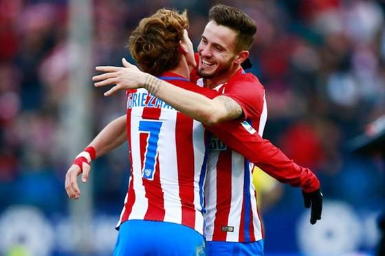 Barca muốn chiêu mộ Saul Niguez (phải) và Griezmann. Ảnh: Getty Images