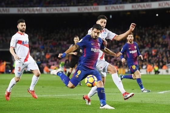 Suarez ghi bàn giúp Barca có 3 điểm.Ảnh: Getty Images