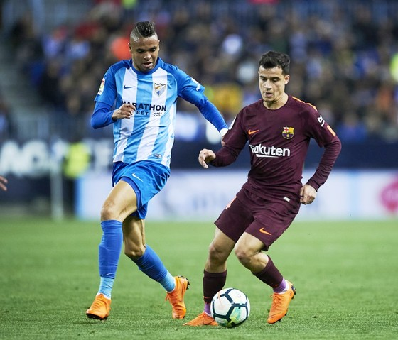 Coutinho (phải) ghi bàn giúp Barca chiến thắng trong ngày vắng Messi. Ảnh: Getty Images.
