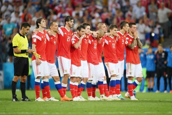 Dù Nga thất bại, nhưng Tổng thống Putin vẫn chúc mừng đội tuyển. Ảnh: Getty Images