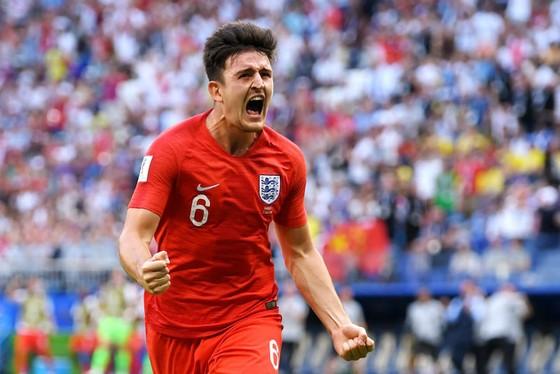 Harry Maguire ghi bàn vào lưới Thụy Điển ở tứ kết World Cup 2018. Ảnh: Getty Images