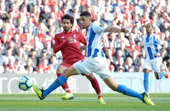 Mohamed Salah (trái) ghi bàn thắng duy nhất của trận đấu. Ảnh: Getty Images