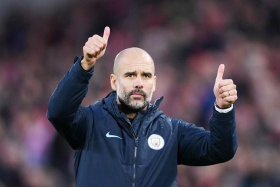 Pep Guardiola tin rằng ông đã hoàn thiện hơn khi làm việc tại Anh. Ảnh: Getty Images