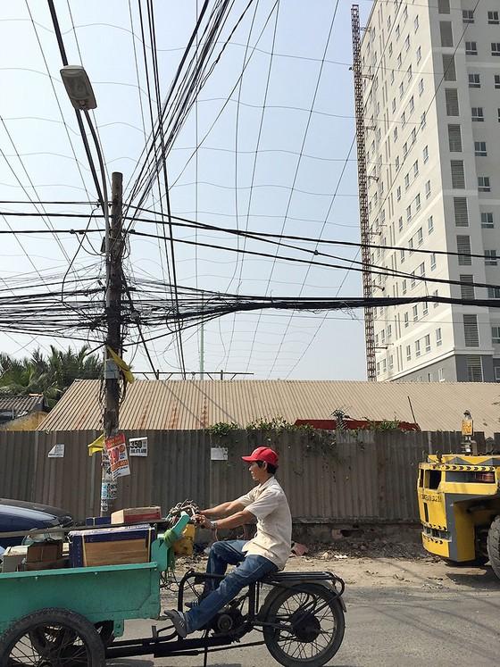 Chuẩn bị điện cho mùa khô: Gỡ vướng đường dây Nam Sài Gòn - quận 8 ảnh 1