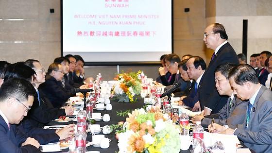 Thủ tướng Nguyễn Xuân Phúc hội kiến Chủ tịch Trung Quốc Tập Cận Bình ảnh 1