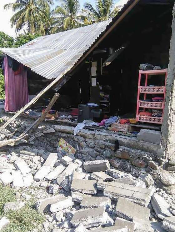Số nạn nhân thiệt mạng do động đất và sóng thần tại Indonesia đã lên tới gần 400 người ảnh 15