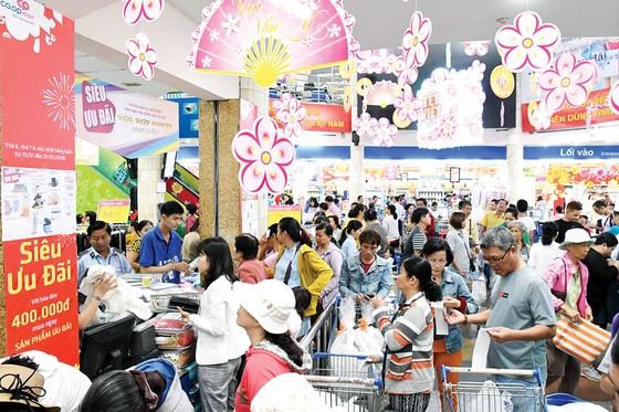 Hệ thống siêu thị Co.opmart và Co.opXtra cam kết giảm giá hơn 5.000 sản phẩm tết ảnh 1