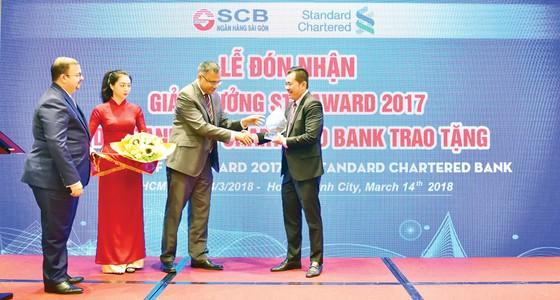 SCB nhận chứng chỉ pci dss lần 2 và giải thưởng thanh toán Xuất sắc từ ngân hàng Standard Chartered ảnh 2