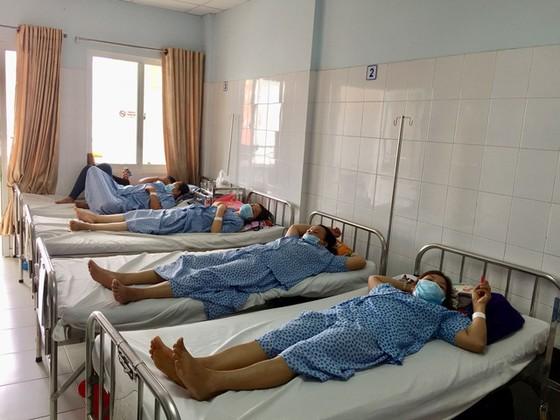 Ổ dịch cúm A/H1N1 lớn chưa từng có trong bệnh viện - Ảnh 1.