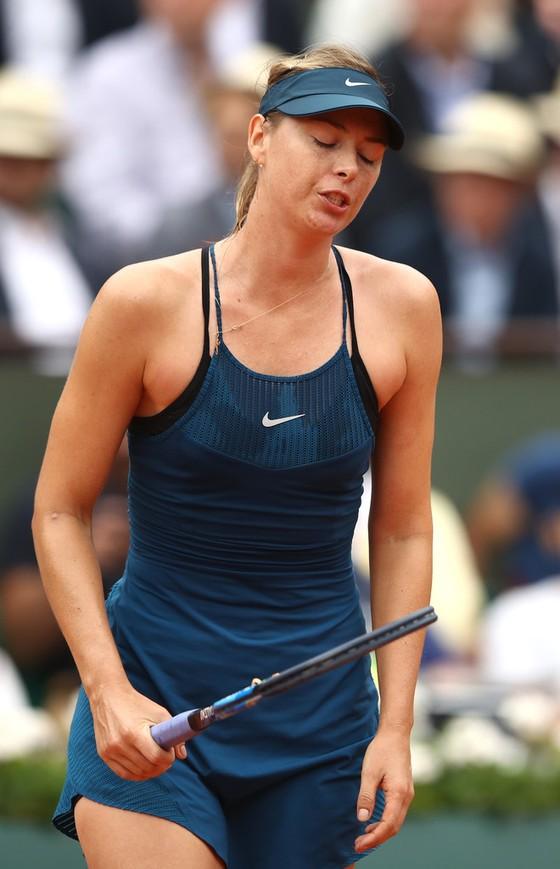Roland Garros 2018: Sharapova thua sốc Muguruza ảnh 1
