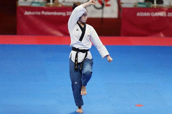 Taekwondo: Đồng đội nam vào bán kết, Châu Tuyết Vân thua VĐV chủ nhà ảnh 4