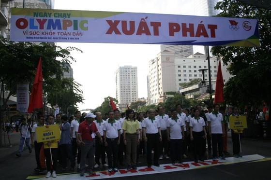 Người dân TPHCM hào hứng tham gia Ngày chạy Olympic vì sức khỏe toàn dân 2018 ảnh 4