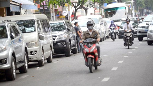 TP.HCM: giữ xe máy giá cao, giữ ôtô giá thấp ảnh 1