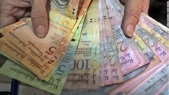 Venezuela tuyên bố phá giá nội tệ ảnh 1