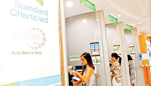 Standard Chartered: Giảm lãi suất, kích đầu tư ảnh 1