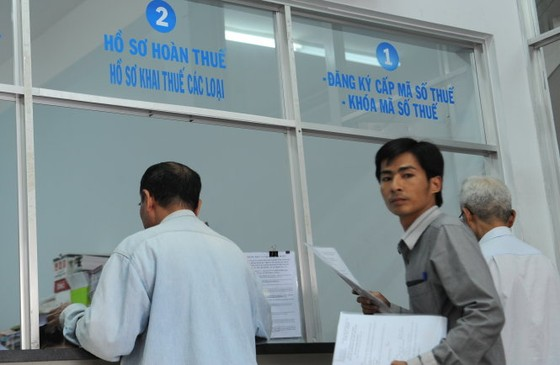 Chậm hoàn thuế, Nhà nước phải trả lãi DN ảnh 1