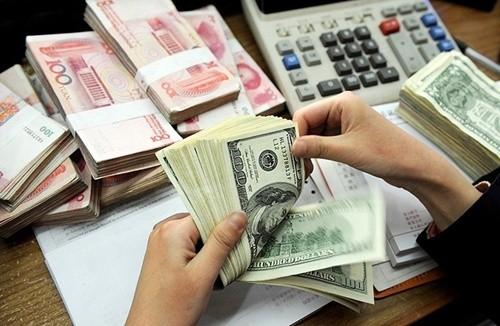 Tỷ giá trung tâm VND/USD tiếp tục giảm ảnh 1