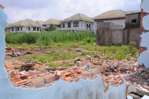 Nguồn lực đất đai - Khoảng cách cơ chế và thực tế ảnh 1