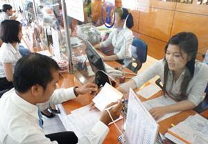 NHNN quyết giữ mức tăng tín dụng 20% ảnh 1