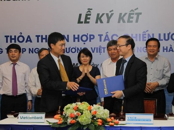 Vietcombank hỗ trợ vốn Ngân hàng Xây dựng Việt Nam ảnh 1