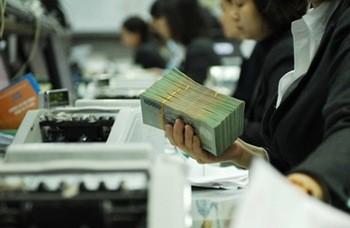 Ngân hàng lên kế hoạch giảm tiếp lãi suất ảnh 1