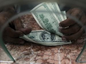 USD bị sức ép xuống giá ở thị trường châu Á ảnh 1