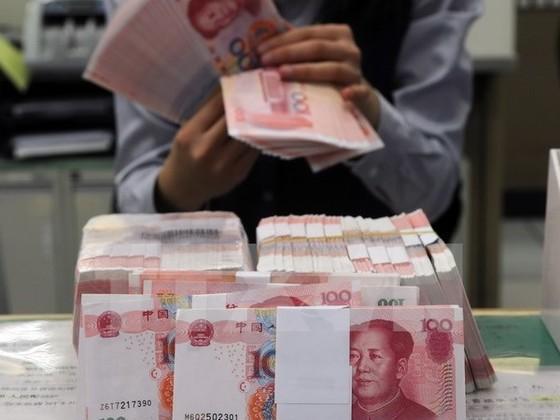 Trung Quốc hạ mục tiêu tăng trưởng GDP xuống 7% ảnh 1