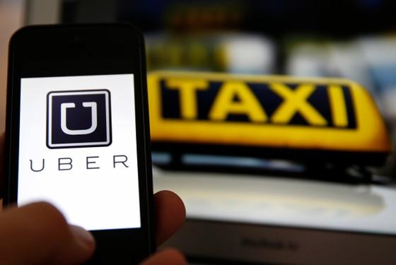 Singapore rà soát quy định quản lý taxi Uber ảnh 1