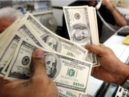 Điều hành tỷ giá nhìn tổng thể nền kinh tế ảnh 1