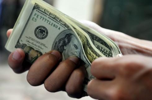 Ngày 21-1 USD bất ngờ tăng giá mạnh ảnh 1