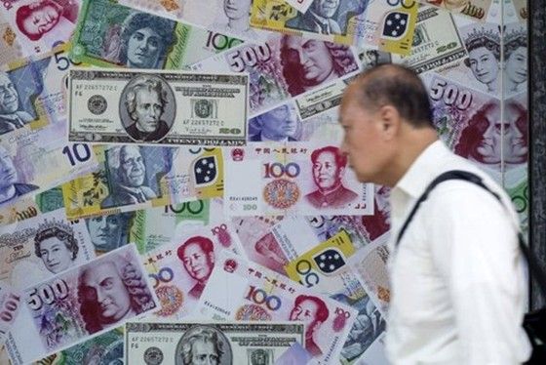 Trung Quốc lại hạ giá nhân dân tệ ảnh 1