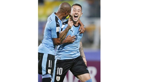 Niềm vui chiến thắng của các cầu thủ Uruguay