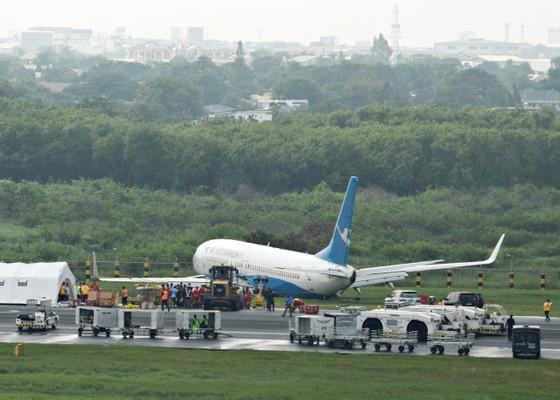 Máy bay Trung Quốc chở 165 người trượt đường băng khi hạ cánh ở Philippines ảnh 1