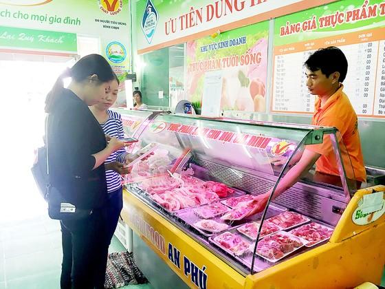 Giá thịt heo tăng, chất lượng không tăng ảnh 1