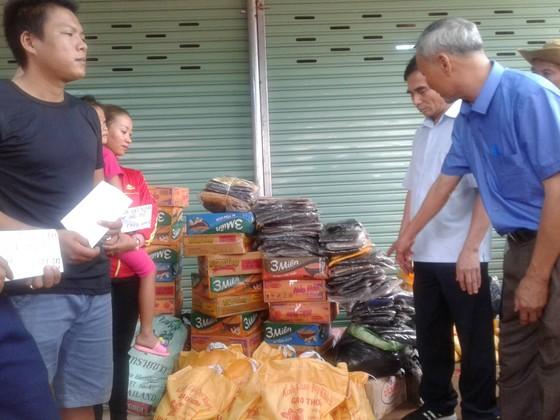 Lực lượng cứu hộ quốc tế đổ về Lào cứu trợ sau vụ vỡ đập thủy điện ảnh 4