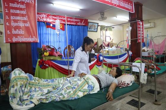 Vỡ đập thủy điện tại Lào: Sinh con trên đường chạy lũ  ảnh 1