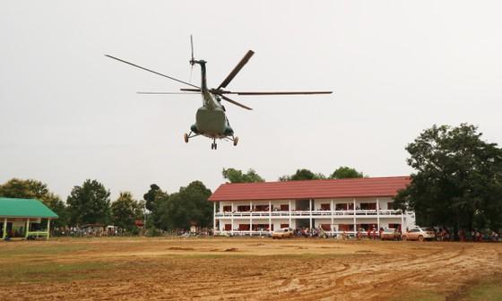 Lực lượng cứu hộ quốc tế đổ về Lào cứu trợ sau vụ vỡ đập thủy điện ảnh 1