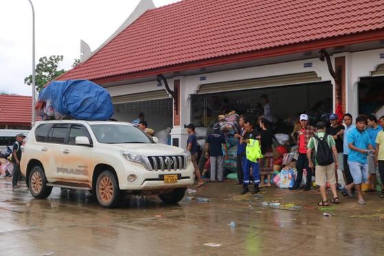 Lực lượng cứu hộ quốc tế đổ về Lào cứu trợ sau vụ vỡ đập thủy điện ảnh 9