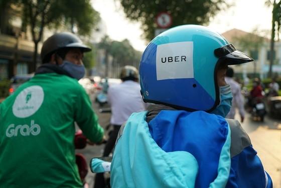 Hoàn tất toàn bộ hồ sơ vụ Grab thâu tóm Uber ảnh 1