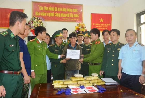 Bắt vụ vận chuyển 60.000 viên ma túy tổng hợp từ Lào vào Việt Nam ảnh 4