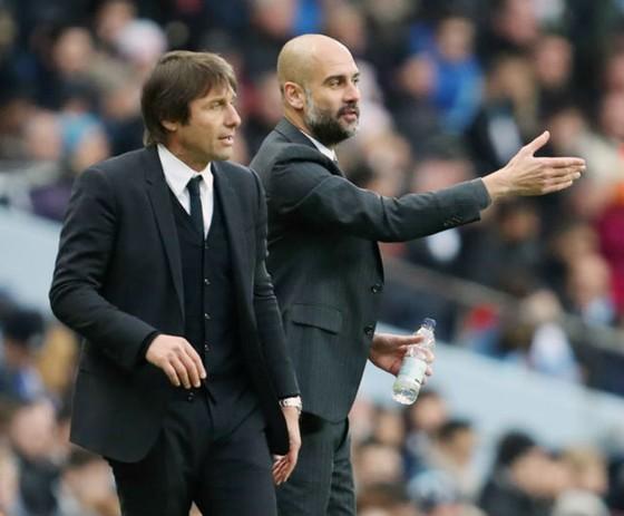"""Antonio Conte (trái) không """"ghen tị"""" với đồng nghiệp Pep Guardiola. Ảnh: Getty Images"""