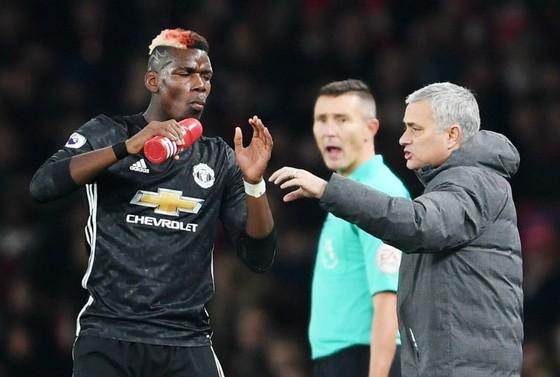 Mối quan hệ giữa Paul Pogba và HLV Jose Mourinho đang rất căng thẳng. Ảnh: Getty Images